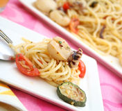 Squids with pasta and tomatoes Royalty Free Stock Photo