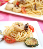 Squids with pasta and tomatoes Royalty Free Stock Photos