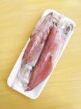Squids on styrofoam pack Royalty Free Stock Photo