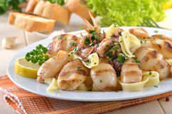 Squids on tagliatelle Royalty Free Stock Photo