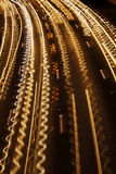 Squiggly Traffic River. Squiggly trails of light is all that remains from the swift highway traffic. The squiggle is caused by intentional camera shake during Royalty Free Stock Photography