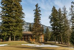 SQUILAX, CANADA - March 16, 2019: Modern Wooden hotel with trees in british columbia on Little Shuswap Lake. Architecture building resort tourism travel stock photos