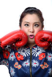 Squint eyed crazy woman in boxing gloves Stock Photo