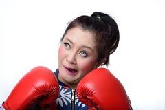 Squint eyed crazy woman in boxing gloves Royalty Free Stock Photography