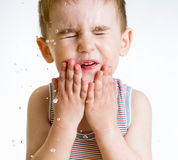 Squint little child washing face Royalty Free Stock Image