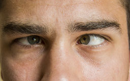Squinting eyes. Strong squinting man eyes close up beauty close up isolated Stock Photography
