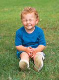 Squinting little boy. Little boy squinting as if waiting for a surprise Royalty Free Stock Photography