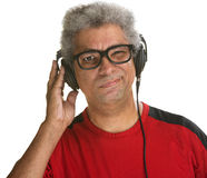 Squinting Man with Headphones Royalty Free Stock Image