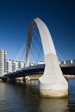 Squinty bridge. The supporting arch of the Clyde Arc bridge in Glasgow, Scotland, against a blue sky stock image