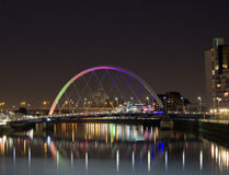 Squinty Bridge Glasgow. Vibrant night shot of the famous Squinty bridge with river clyde reflection Stock Photography