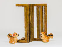 Squirrel Cerimic On Wooden Bench In The Park Royalty Free Stock Photo