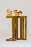 Squirrel Cerimic On Wooden Bench In The Park Stock Image