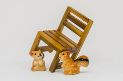 Squirrel Cerimic On Wooden Bench In The Park Stock Photos