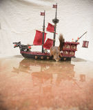 Squirrel drinks water on a pirate ship Royalty Free Stock Images