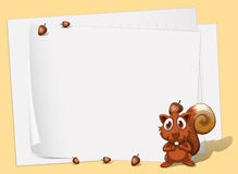 A squirrel in front of the empty papers Stock Photo