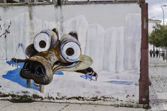 Squirrel graffiti. Mérida, November 2012. Ice Age graffiti on a wall on street. Scrat squirrel cartoon represented Stock Image
