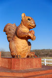 Squirrel with Pecan. Ms. Pearl a giant squirrel stands on the side of Hwy 71 in Cedar Creek, TX Stock Photos