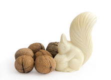 Squirrel from white chocolate with nuts Stock Images