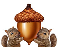 Squirrels Holding An Acorn. As friendly teamwork of cute furry rodent characters gripping a giant nut signage for advertising and marketing as a message from Stock Photo