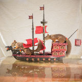 Squirrels on a pirate ship. Red squirrels standing on a pirate ship Royalty Free Stock Images
