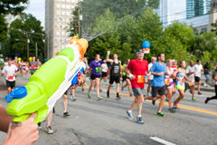 Squirt Gun Soaks Runners In Atlanta Peachtree Road Race Stock Photo