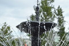 Squirt, splash water fountain. Part of the city fountain Stock Photos