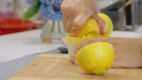 Squishing lemon and making juice while cooking cheese cream cake with blueberries. Squishing lemon and making juice while cooking no baking cheese cream cake stock video