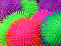 Squishy balls with spines. Colorful background of squishy balls with spikes or spines Royalty Free Stock Images