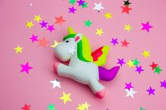 Free Squishy Toy  Unicorn And Glitters In The Shape Of Stars On Pastel Pink Background Stock Images - 142279224