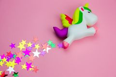 Free Squishy Toy Unicorn And Glitters In The Shape Of Stars On Pastel Pink Background Stock Image - 142279291