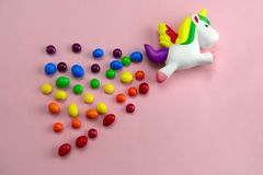 Free Squishy Toy Unicorn Is Flying On A Candies Rainbow On Pink Background Royalty Free Stock Image - 163648246