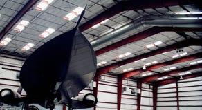 An SR-71A Blackbird. Looks like it's going Mach 3 even when it's sitting in the hangar stock photo