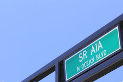 SR A1A N Ocean Blvd Sign. Outdoor green and white, painted metal, State Route A1A North Ocean Boulevard street sign. SR A1A N Ocean Blvd overhead on a public royalty free stock photography