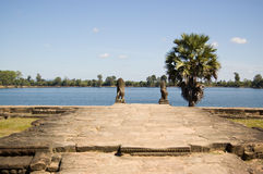 Srah Srang Reservoir, Angkor, Cambodia. View along the west platform of the ancient Srah Srang reservoir, Angkor, Cambodia.  Known as a Baray, the man made lake Stock Photography