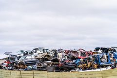 Junk Cars Stacked in Scrap Yard for recycling stock images