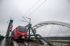 Srbija Voz EMU electrical unit from Serbian railways crossing Zezeljev Most, also called Zezelj bridge, on its way to Belgrade. NOVI SAD, SERBIA - FEBRUARY 3 stock photo