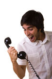 Sreaming at the telephone. Young men screaming to the telephone receiver Royalty Free Stock Photography