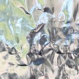 Srebna folia z błyszczącą powierzchnią dla tła Zdjęcie Royalty Free