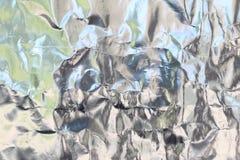 Srebna folia z błyszczącą powierzchnią dla tła Fotografia Royalty Free