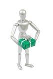 Srebna marionetka trzyma zielonego prezenta pudełko Obraz Royalty Free