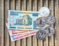 Srebne crypto monety Litecoin LTC, papierowy wyznania Belarusian rubel Metal monety kłaść out w płaskim tle, zakończenie vi obrazy stock