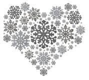 Srebny kierowy kształt od płatków śniegu na bielu zdjęcia stock