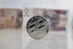 Srebny Litecoin połysku menniczy pobliski pieniądze Obraz Royalty Free