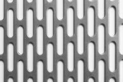 Srebny metalu talerz z dziurami Zdjęcia Stock