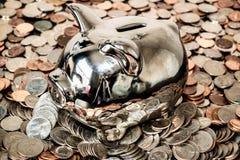Srebny prosiątko banka monety stos Zdjęcia Stock