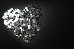 Srebny serce na czarnym tle zdjęcie stock