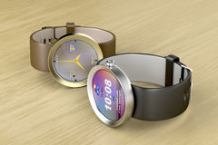 Srebro i złociści mądrze zegarki Fotografia Stock