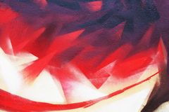 SRed flame abstract street art. Background image of a fragment of a colored graffiti painting in red tones. Street art. Abstract background image of a fragment royalty free stock photography