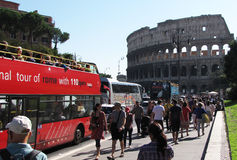 A sreet full of tourists heading to The Coliseum. stock photo
