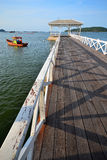 Sri chang island. White long wooden bridge juts out into the ocean Stock Images